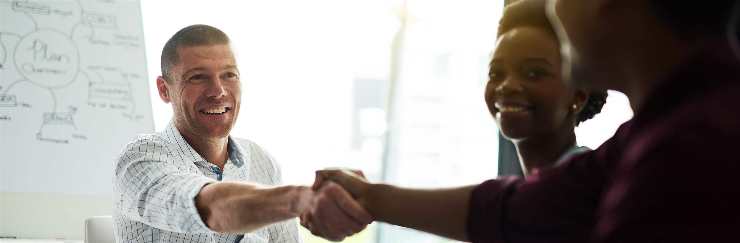 Cropped shot of businesspeople shaking hands during a meeting in an office