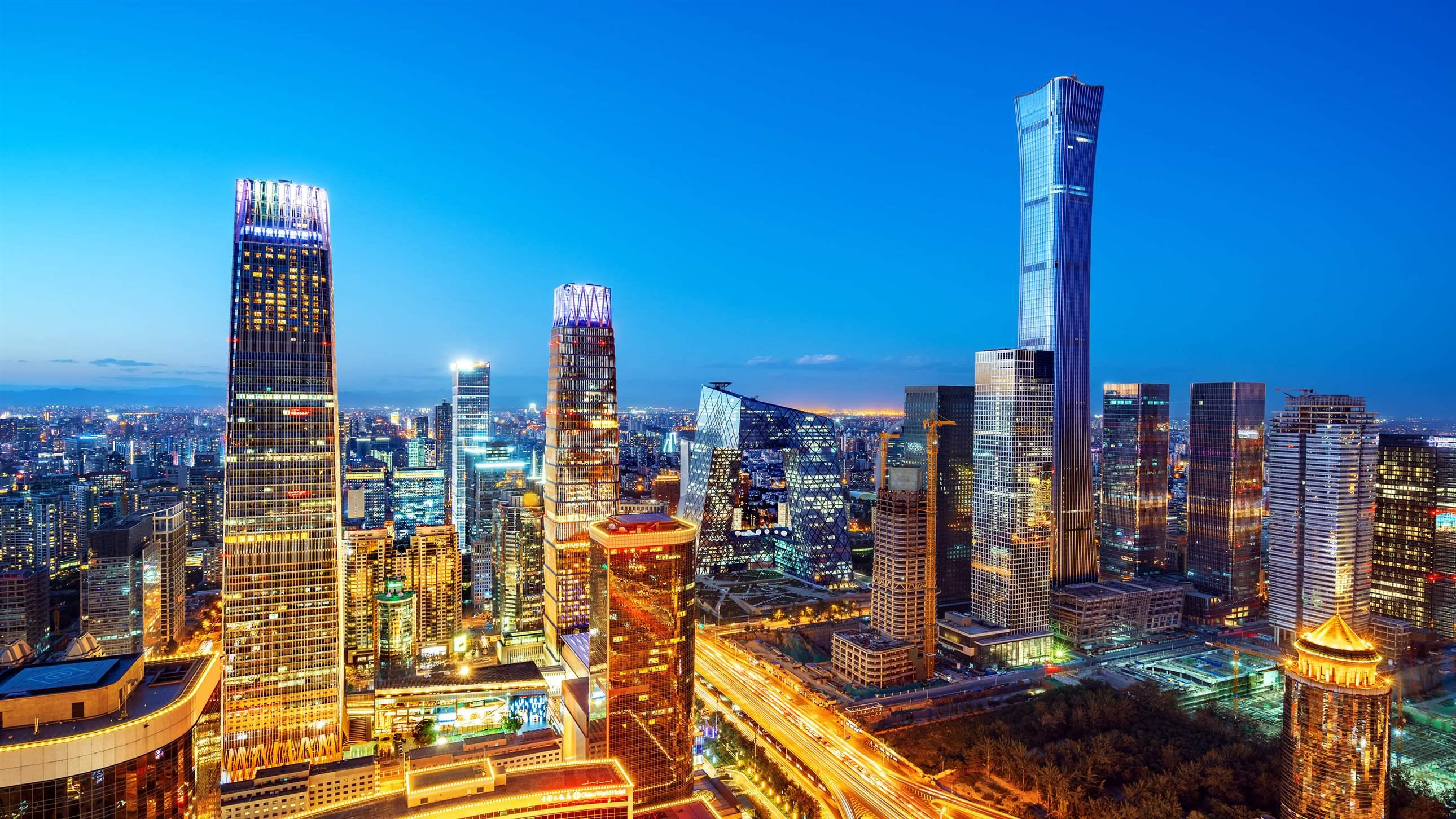 High-rise buildings and viaducts in the financial district of the city, night view of Beijing, China.
